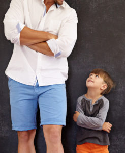Co-parenting role modeling boy looking up at Dad