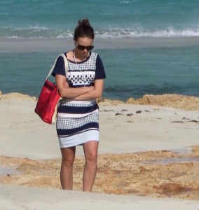 Woman walking on beach grieving